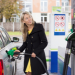 woman putting gas in her car